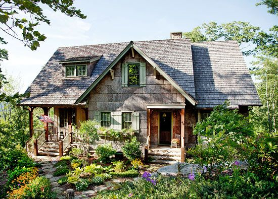 The front porch of this summer cottage faces out into the Blue Ridge Mountains of North Carolina - Traditional Home®  Photo: Emily Followill