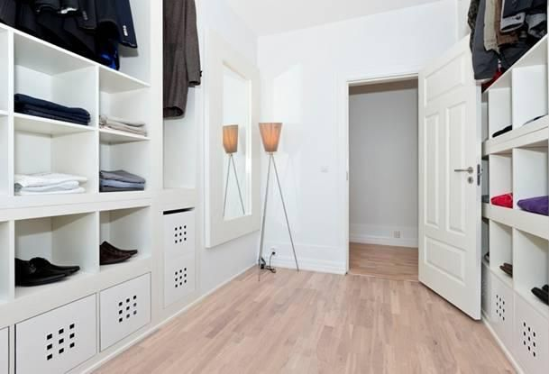 Furniture, Clean Style Picture Wall White Color Wall Large Shaped Natural Wooden Style Flooring The Style Decoration Picture Of Designing A Walk In Closet The Lamp On The Flooring Some Cloth ~ Cool Designing A Walk In Closet That Can Be The Best Ideas To Decorate Your Style Of Room