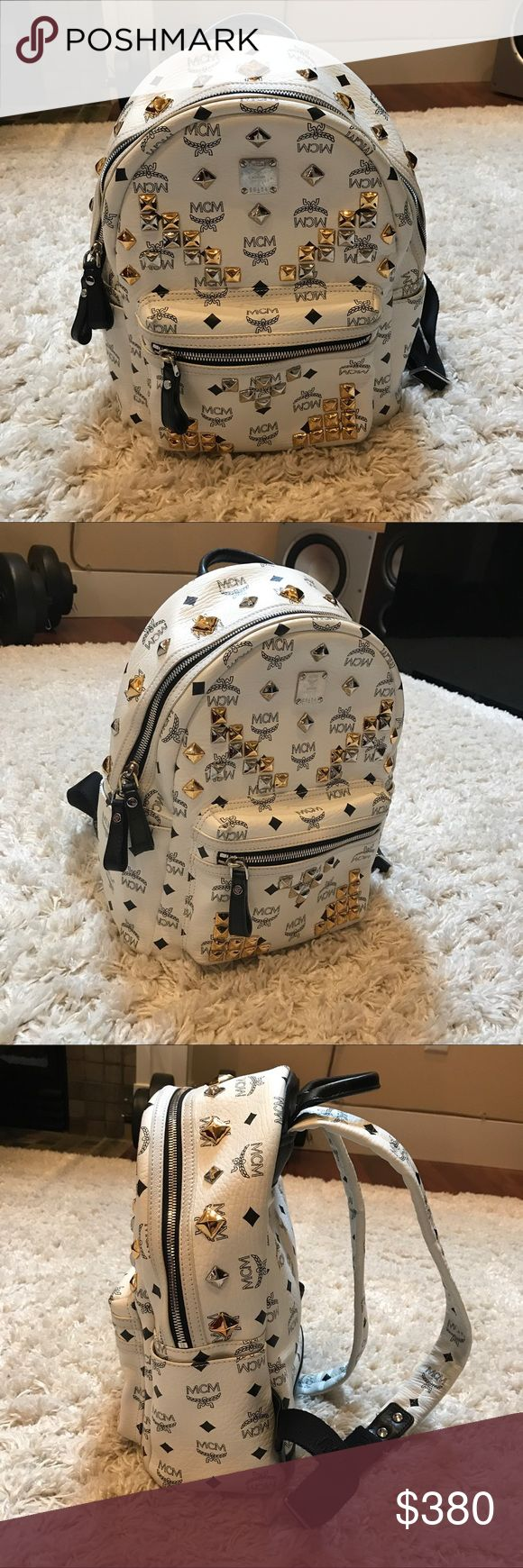 MCM ✨ Small White Studded Backpack 🎒 Originally got it in Korea. The bottom of the backpack has black stain and a little yellow on edges because it's just kind of unavoidable with white leather. But in overall GOOD condition!! And I believe it's SIZE SMALL. MCM Bags Backpacks