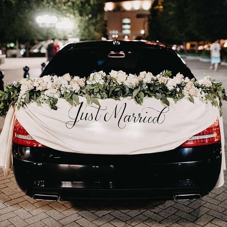 Going out in style just married on the getaway car hand