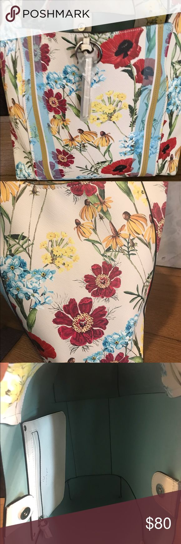 """Nanette Lapore Floral Shoulder Bag A beautiful Floral Print Shoulder bag by Nanette Lapore. Wide strap for shoulder comfort;magnetic closure, one zippered compartment. A deep bag to house all your essentials. This Floral Print is absolutely lovely. Approximate measurements: Length 12"""", width 14"""", depth 6"""" ships same day 📫🎁 Nanette Lepore Bags Shoulder Bags"""