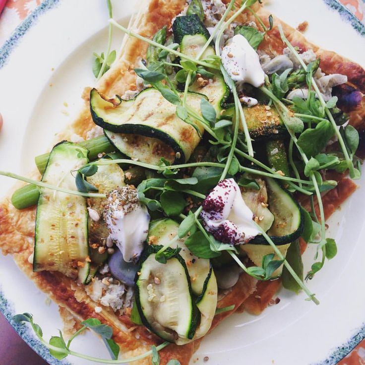 Spring tart piled high with masses of griddled asparagus and courgette - I love a quick ready-made puff pastry dinner. From @deliciousmag updated with charred broad beans, @growing_underground microherbs & Alpro Go-on. /// pita wrap tortilla grillad sparris aubergine zucchini kronärtskocka