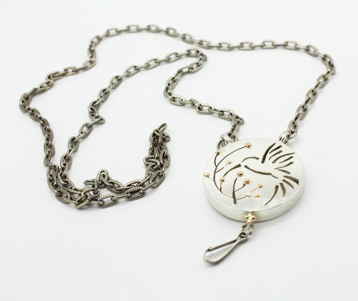 Cell phone neck chain with humming bird pendant.  Sterling silver, 14k yellow gold accents