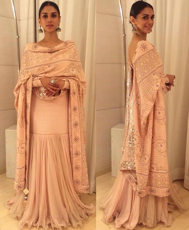 """Love this canny mix of peach and silver. @aditiraohydari wears @sukritiandaakritiofficial."""