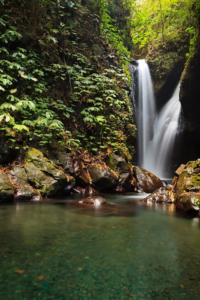 One of the many cascades of Gitgit waterfall, known locally as Air Terjun Gitgit, surrounded by a beautiful rain forest located near to Lovina in northern Bali.