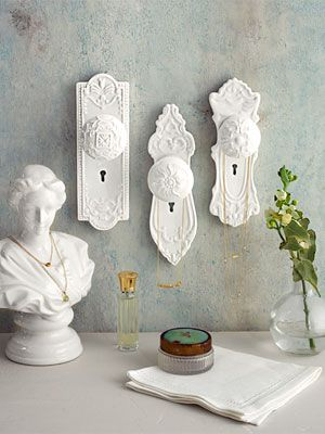 Idea:  We could have some barn wood and attach some cool door knobs, then we can hang place settings from the knobs in alphabetical order (have an a-d knob, e-h, etc).  Thoughts?