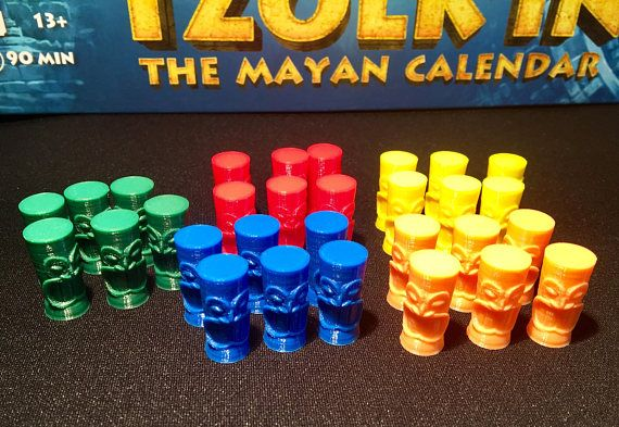 Place your workers in on the calendar wheels of Tzolkin: The Mayan Calendar where you think they will provide the best resources to improve your standing with the gods (Quetzalcoatl, Kukulcan, and Chaac). Instead of using cylindrical pieces of wood, try these tribal player pieces to enhance the