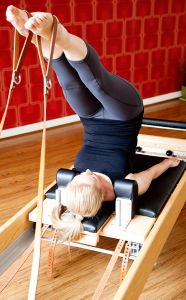 What is #ClassicalPilates #pilates #reformer Mel doing the Short Spine Massage on the Pilates Reformer