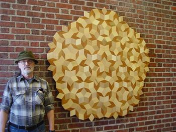 The somewhat famous Penrose Tiles are also Phi Proportional - discovered by mathematician Roger Penrose in the 1960s - they are one of the only ways to tile a plane with pentagonal symmetry