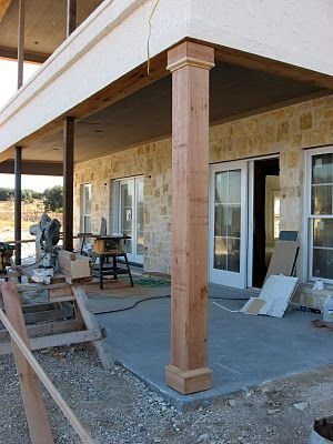 Cedar wrapped columns over existing round pillar posts to match ceiling on  back porch