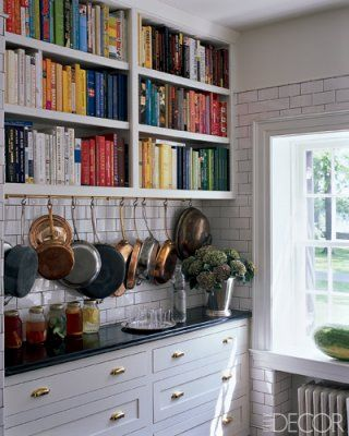 cookbook library, hanging pots and pans, white subway tile, and lots of
