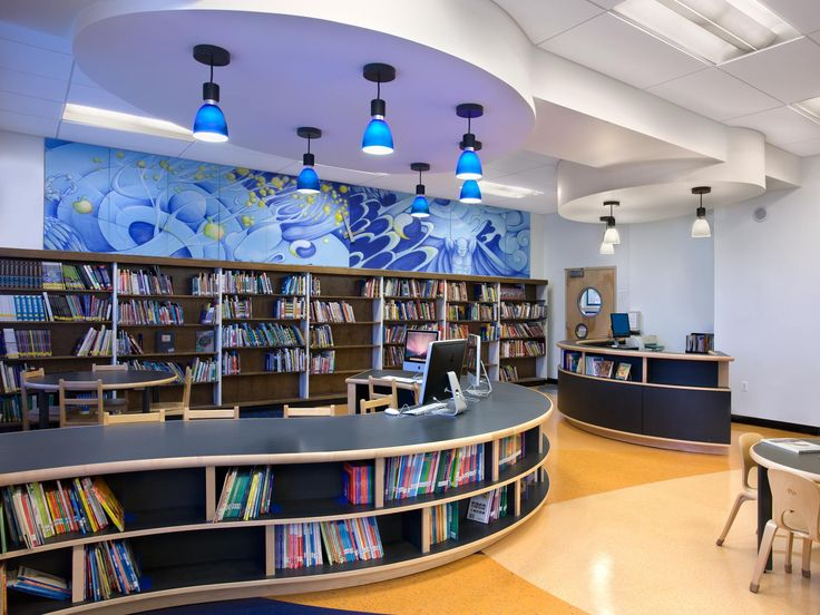 Our design for the new library at The Carroll School, a public elementary school in Brooklyn, was part of a collaboration with the parents and school administrators who collectively participated in the project's programming and fundraising for the $200,000 project. We created an abstract solar system pattern in the natural linoleum flooring and our custom…