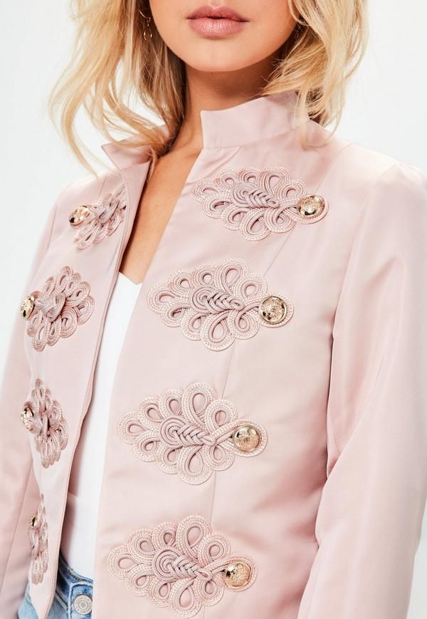 Holla at this new recruit and go military style with this premium jacket - featuring a blush pink hue, gold button detailing, a cropped length and satin finish.