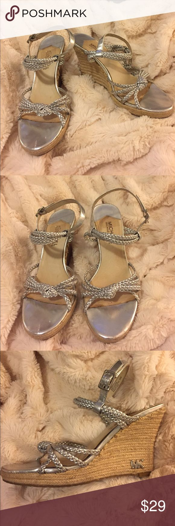 Michael Kors Silver Wedges Michael Kors Silver braided wedges. These shoes are great for any outing and perfect for weddings! These shoes have normal wear with slight scuffing and peeling as shown in photos. Size 6 ½ but seem to fit on the smaller side. 🌟Open to reasonable offers!🌟 Michael Kors Shoes Wedges