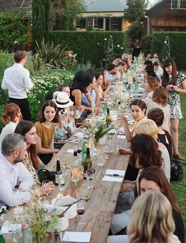 For a large wedding, feed them outside- potluck! VERY affordable; and one of the most fun weddings I ever went to!