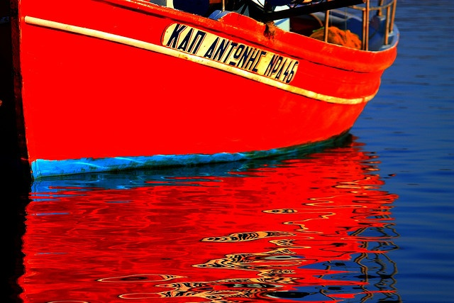 Red boat reflection in the waters off Karystos, Evia Island, Greece by © Marite2007, via Flickr.com