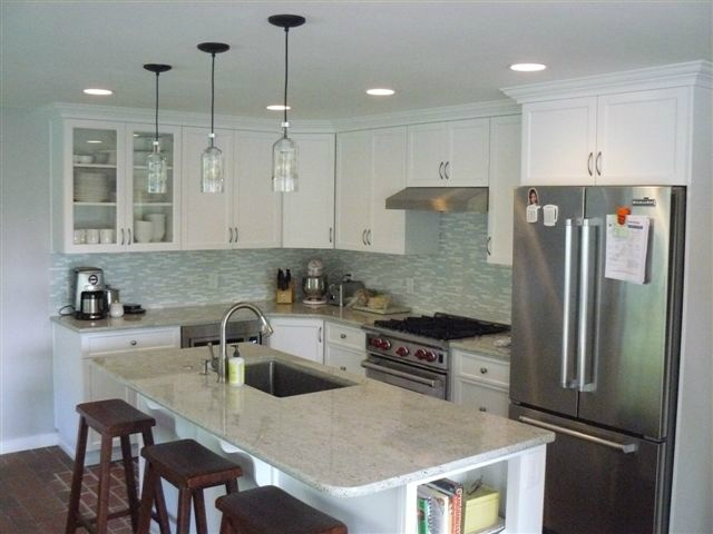 White Shaker Style Cabinets With Glass Tile Backsplash. Kitchen Plus, Bellevue  WA