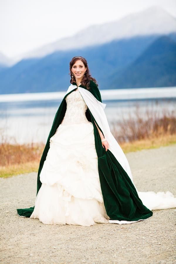 Beautiful reversible white and forest green deep hooded winter cloak from one of An Awfully Big Adventure's weddings. Photo by Earthling Photography