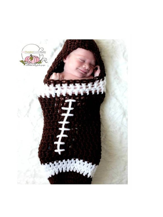 Baby foot ball cocoon. This is cute enough to make me want to dress Maggie like a cheerleader for Halloween!