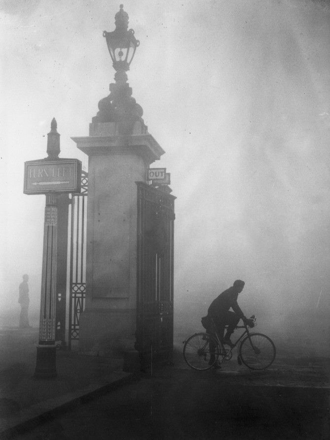 cyclist tries to find his way through thick fog at london's hyde park corner, october 25, 1938. fog like this is known by the nick-name pea soup or a pea souper.