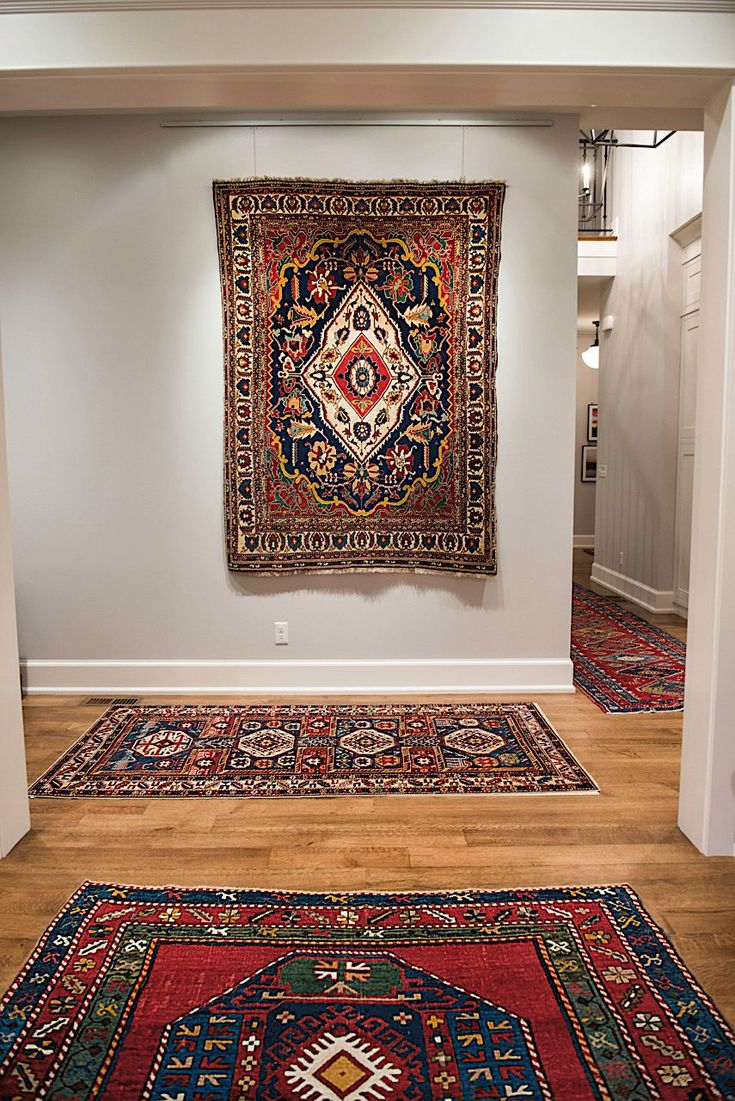 Featured Client's Home Immersive Assemblage of Several Top-Level Tribal Rugs Transforms Passageway Into Inspirational Oasis. Click to read more about this client's home.