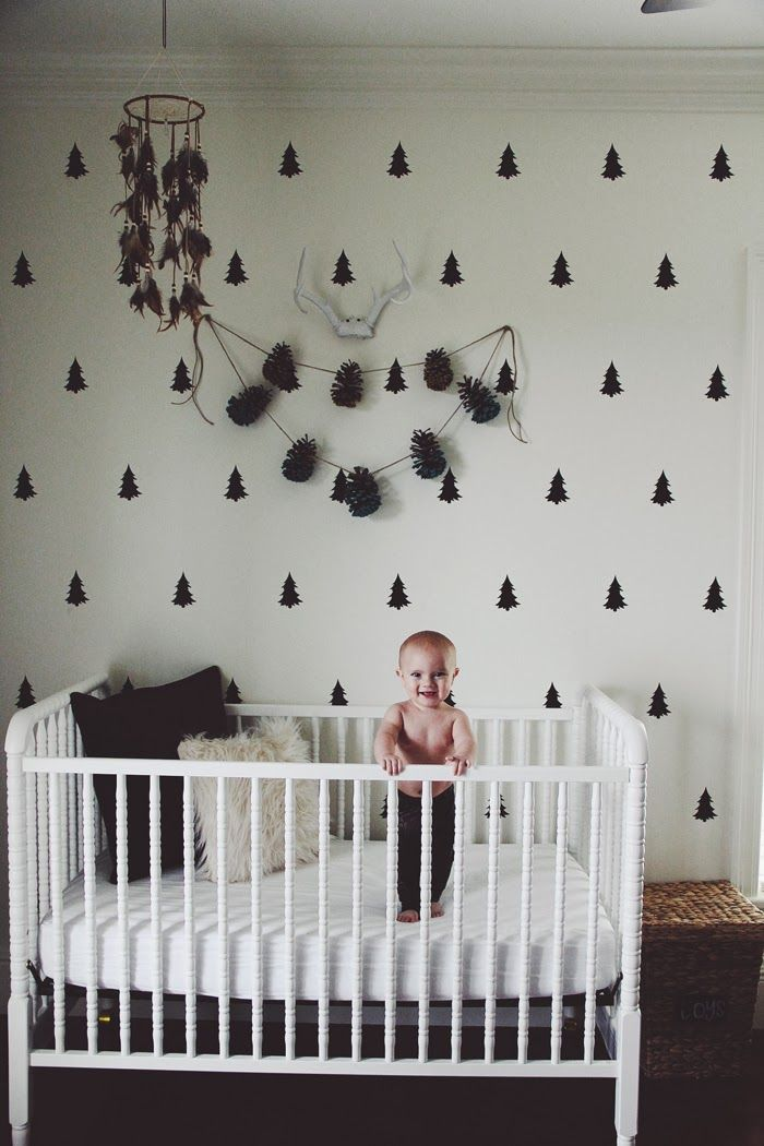 Poppytalk: stenciled tree wall, feather mobile, white Jenny Lind crib. LOVE the stenciled trees!!!
