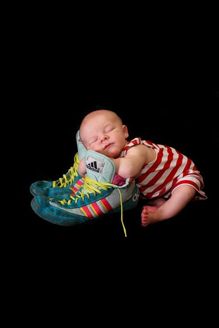 Newborn pics with wrestling shoes
