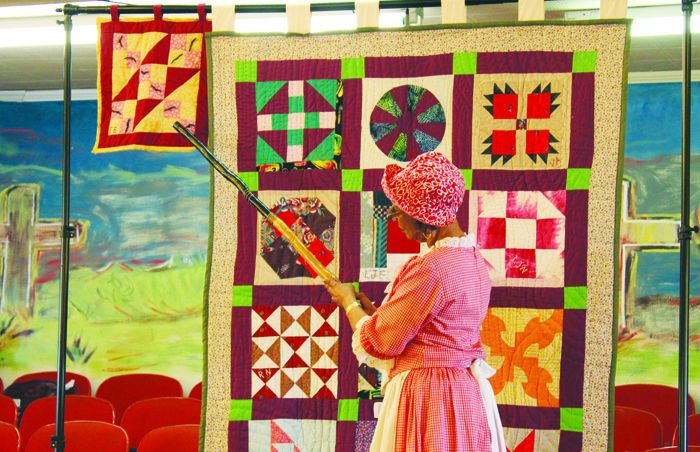 The Quilt Club of Linden, Texas gave a history lesson in how quilt patterns were used to communicate secret messages to escaping slaves traveling along the Underground Railroad at New Mount Zion Missionary Baptist Church