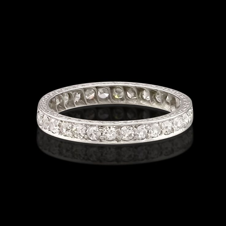 "Art Deco platinum 2.5mm band ring featuring thirty single cut diamonds totaling approximately 0.75 carat.  The ring is engraved ""R.A.-B.P."" as well as ""12-6-22.""  The ring is a size 5.5 and weighs 2.2 grams.  CLICK PLAY ICON TO WATCH VIDEO"