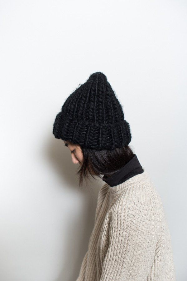 This thick knit beanie will keep you warm all winter long. Available in Beige, Grey or Black. - 100% Acrylic - Imported