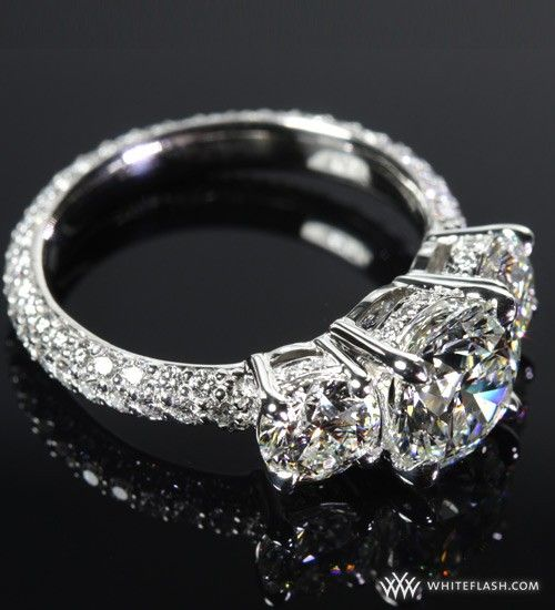Beautiful Brides and Handsome Grooms:  This 3 Stone Pave Diamond Engagement Ring is sure to stun set with a 1.72 Whiteflash A Cut Above diamond set next to 2 x .28ct side stones. 1.4 ctw of Whiteflash A Cut Above diamond melee scatters this 3/4 eternity band.