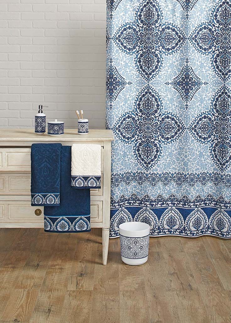 A bathroom of beautiful, bold blue. Try our Indigo Arabesque Shower Curtain and coordinating accessories to bring the color of the season into your home.
