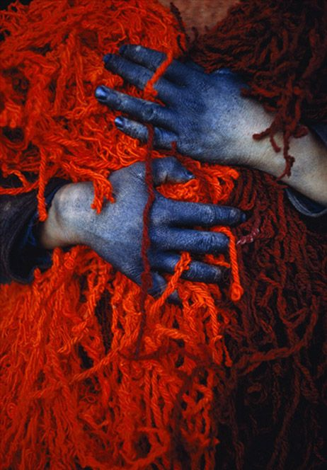 A dye-workers hands carrying threads in Khulm, Afghanistan