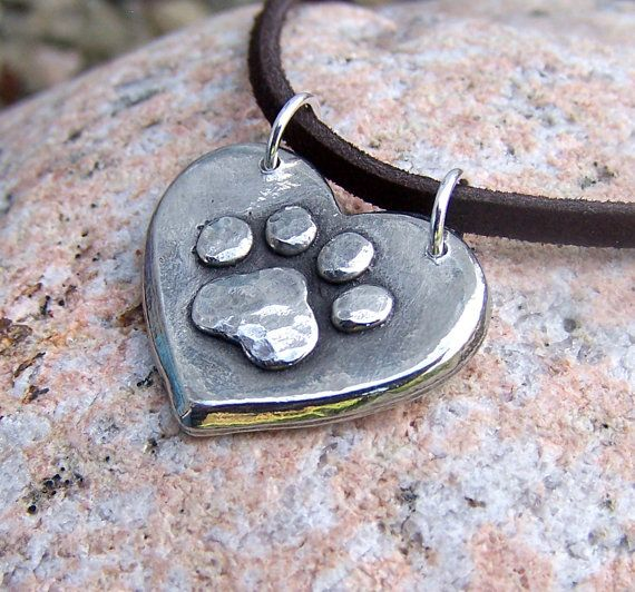 I have one of these pendants! I get so many compliments on it!!    Paw Print on my Heart Necklace Dog Cat Pet by KDemARTe on Etsy, $19.00