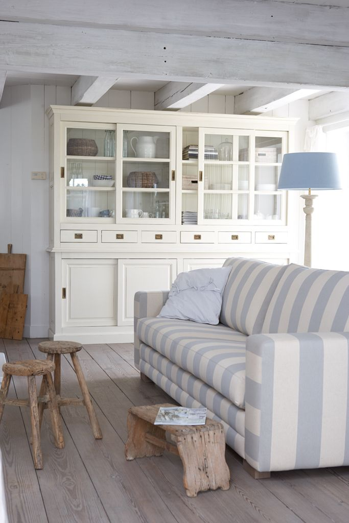 Stripes are my fav!! blue and white go very well together in the living room. Rustic floors and benches. wooden roof and cabinet