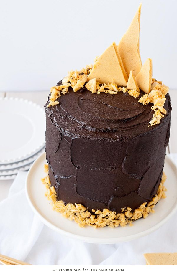 Dark Chocolate Honeycomb Cake - a rich chocolate layer cake recipe with ultra dark, fudgy frosting and homemade honeycomb | by Olivia Bogacki for TheCakeBlog.com