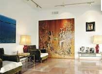 Οικία Άγγελου Λητώς Κατακουζηνού. Το διαμέρισμα των Κατακουζηνών στη λεωφόρο Αμαλίας ήταν ένα από τα σημαντικότερα φιλολογικά σαλόνια της γενιάς του 30. Ποιητές,