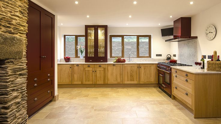 Solid oak furniture, combined with painted accents and Silestone worktops. Designed by Stewart MacPherson at Treyone