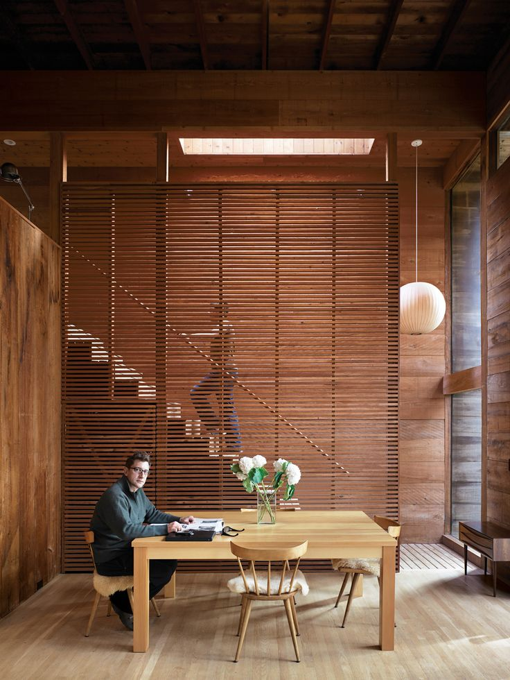 A really nice way to create a slatted wood partition without  putting in an actual wall.