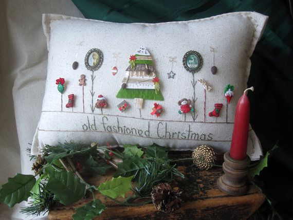 This Christmas-themed hand-made muslin needlework pillow is perfect for holiday decor and celebrating the season! Size is approximately 16 x 8.