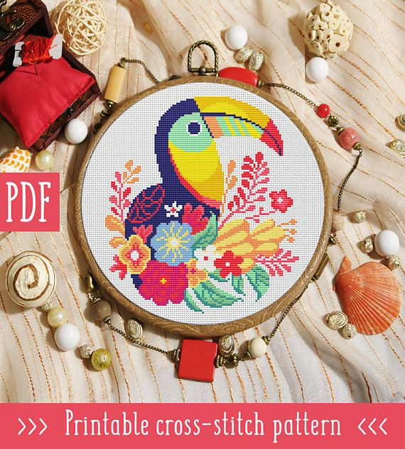 Toucan Flowers Cross Stitch Pattern This pattern is an instant download PDF. Size: 98w x 110h stitches 14 Count Aida: approx. 7.00 x 7.86 inches or 17.78 x 19.96 cm Stitches Required: Full cross stitches Colors Required: 13 DMC floss colors PDF Included: - Pattern in color symbols