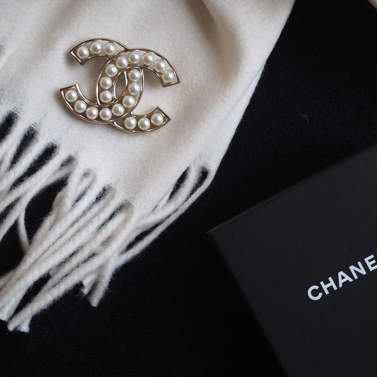 CHANEL brooch on cashmere scarf
