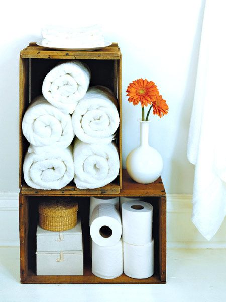 Take crates that once teemed with clementines or old flea-market finds originally used for wine bottles and convert them into storage for towels in the bathroom or T-shirts in the bedroom.Tip: A single crate provides useful, efficient storage in tight spaces. Two or more together look like a piece of furniture. (Photo: Photo: Antonis Achilleos; Stylist: Matthew Gleason)