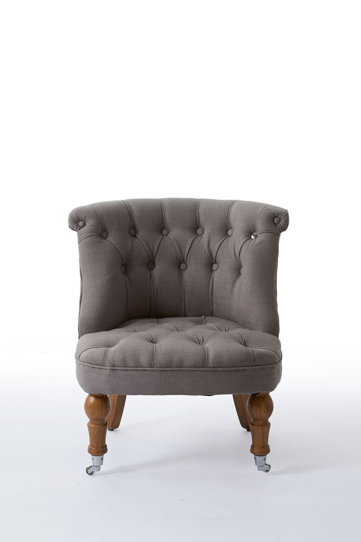 Кресло серое с капитонами на колесиках