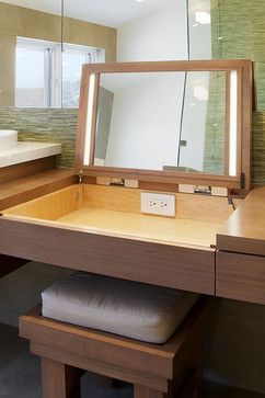Make-up vanity - I don't know that I like this exactly as is, but I LOVE the idea of shutting makeup, etc. unseen and having an outlet right there for hair dryer/straightener!