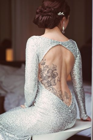 This may change my mind on back tattoos. With my love of classy, backless dresses I thought a tattoo would throw it off. But she still looks beautiful