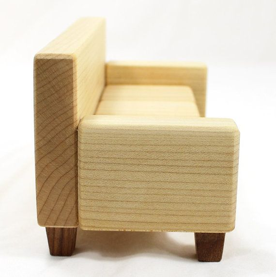 This is a one inch scale miniature sofa or couch. The wood you see is natural - there are no stains or dies used. The light wood is maple and the dark wood feet are oak. The wood is power and hand sanded smooth and finished with linseed oil. The sofa is 6-1/2 inches wide, 3 inches