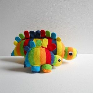 Pair of rainbow sock stegosaurus, dinosaur, sock animal,...