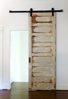 Make a standard door a sliding door using barn door hardware. (use my vintage mirror door}