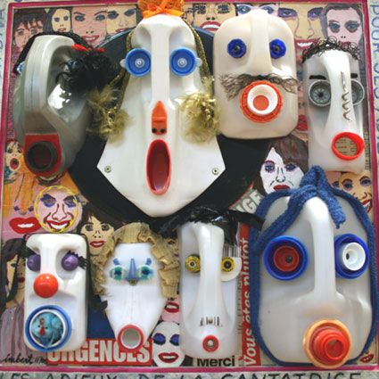 Funk recycled jug masks you could definitely make with the kids.  #recycle #art